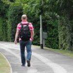 Adult with backpack walking away