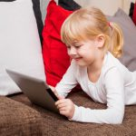 Young Girl Using iPad