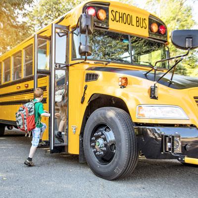 young children boarding school bus